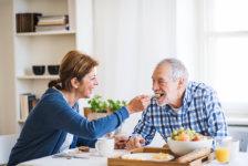 A senior couple sitting having breakfast