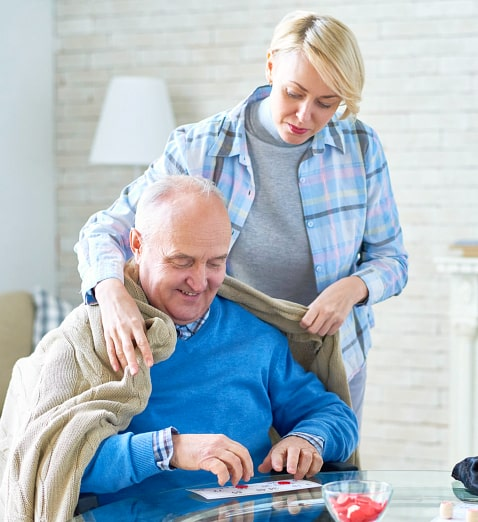 caregiver caring for elder man