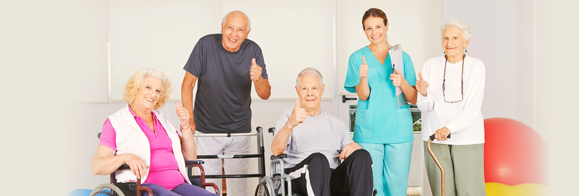group of elderly people showing their thumbs up