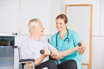 caregiver and elder man doing physical therapy